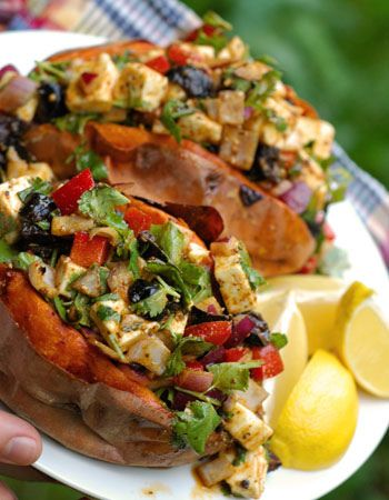 Sweet potato topped with spicy black olive/ feta salad. I dream about ...