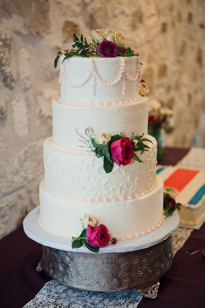 We love the white on white detailing on this gorgeous cake! #cake #wedding