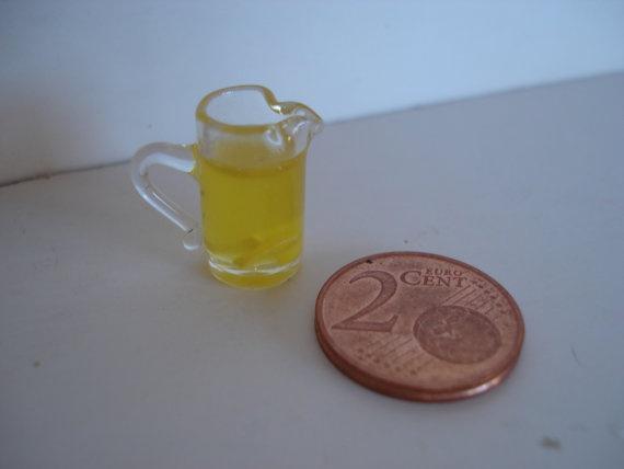 Miniature glass pitcher of lemonade by cinen