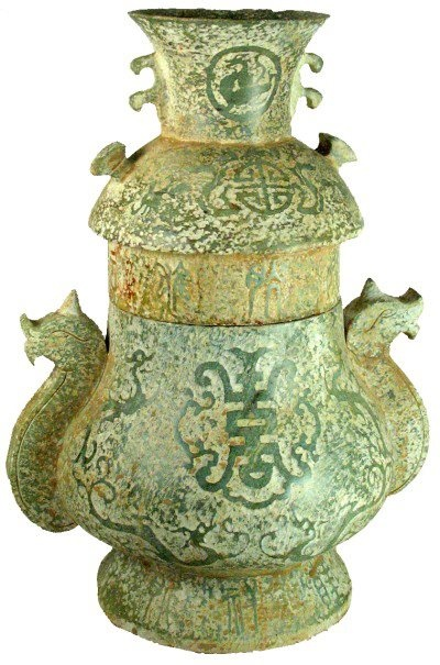 "Jade container with a lid, griffin handles and dragons. Chinese writings on the body and lid. Western Zhou.  500 BC 12 ""× 9"""