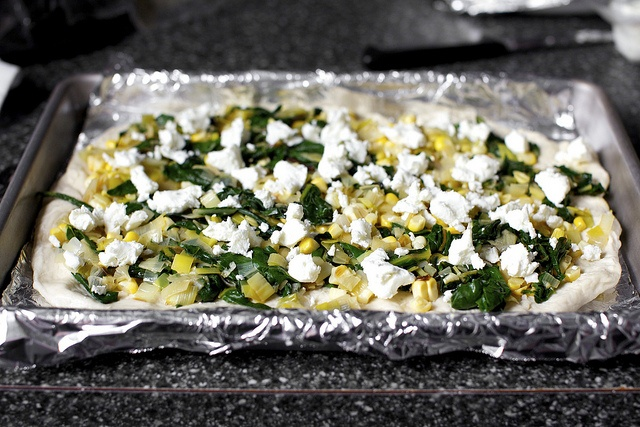 leek chard and corn flatbread ready to bake by smitten, via Flickr