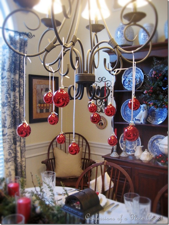 Hang ornaments from chandelier i 39 m home for the holidays for Hanging ornaments from chandelier