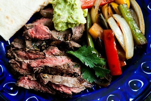OF SKIRT STEAK, ONIONS AND BELL PEPPERS, AND SERVED SIZZLING HOT ...