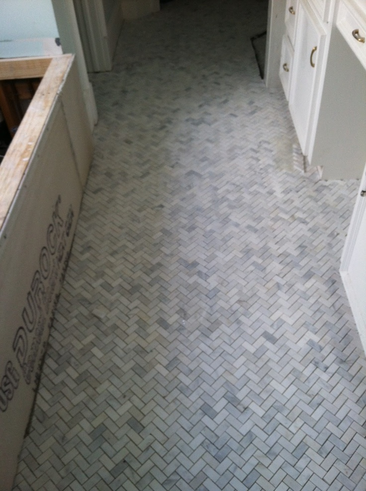 Herringbone bathroom floor tiles amazing orange for Small bathroom herringbone tile