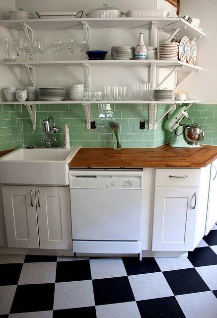 marmoleum checkerboard floor + green subway tiles + white cabinets ...