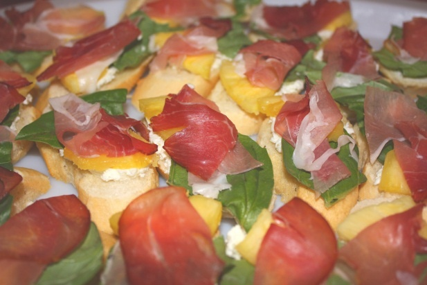 Crostini w/Goat Cheese, Basil, Prosciutto, and Pineapple.