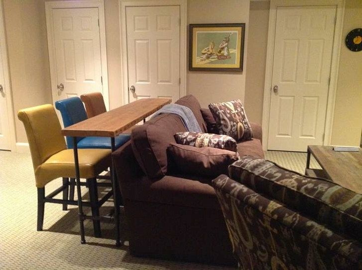 Bar stools and table behind couch for extra seating definitely