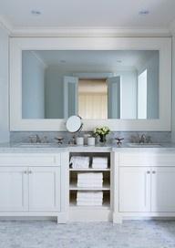 white bathroom vanity and large mirror