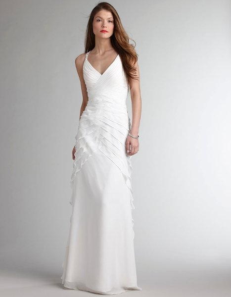 We spent an hour or so designing the dress from my ideas and with her fantastic input, and it was ready for the first try-on within a month and a half. Amazing, considering the ready-made shop down the street charged rush fees if you were ordering within 5 months of your wedding.