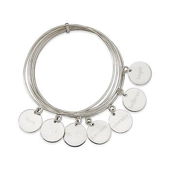 """Set of 7 Word Charm Bangle Bracelets In Sterling Silver. Seven words to live by: """"love,"""" """"hope,"""" """"trust,"""" """"courage,"""" """"believe,"""" """"eternity"""" and """"passion"""" are engraved on charms that dangle from a set of seven bangles. Presented in sterling silver with a ba"""