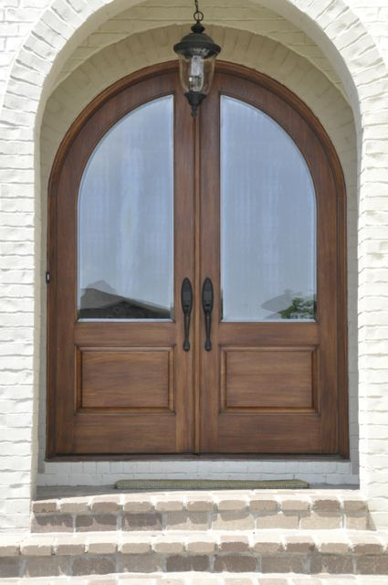Wood arched french front door elegant elegant entryways for Wood french front doors