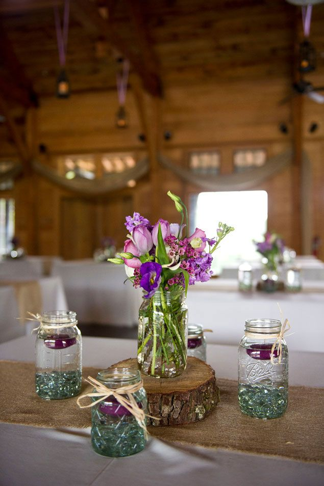 Rustic mason jar centerpieces going to the chapel