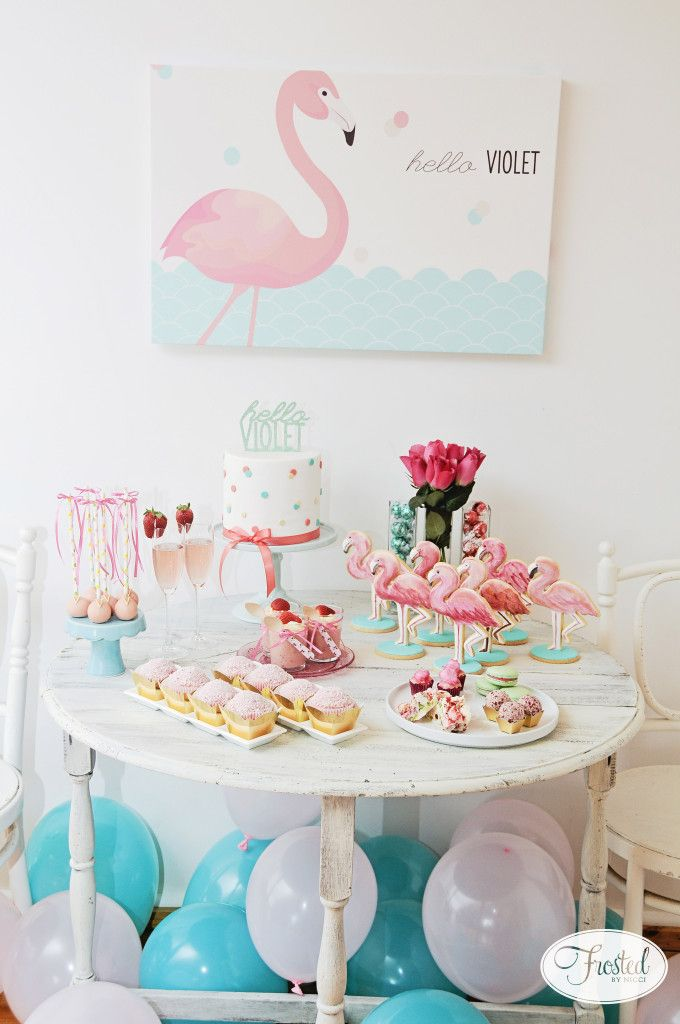 Adorable dessert table at a flamingo-themed sip and see party