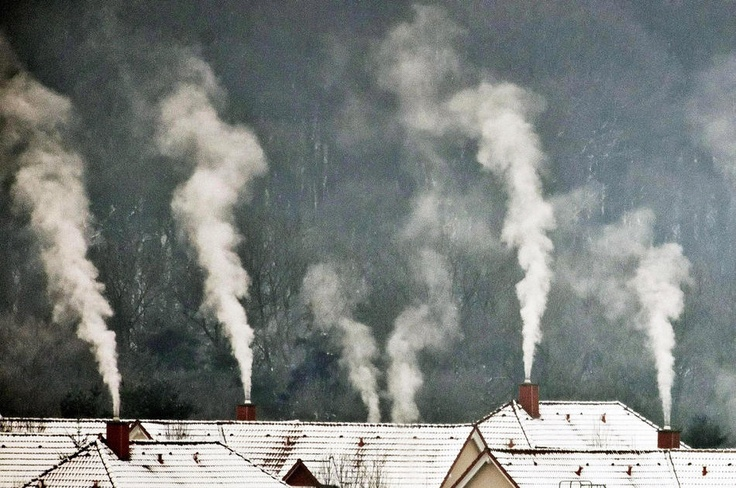 Smoke rises from chimneys on a cold winter morning near Weimar, central Germany, Tuesday, Feb. 7, 2012 Jens Meyer