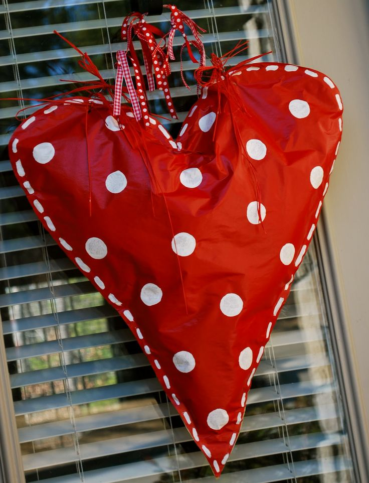 A great Valentine door decoration, made from kraft paper, paint, stuffed with plastic bags, and covered in a clear acrylic spray to keep it from getting soggy.