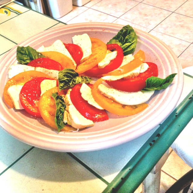 Caprese salad: sliced red & yellow tomatoes, sliced smoked mozzarella ...
