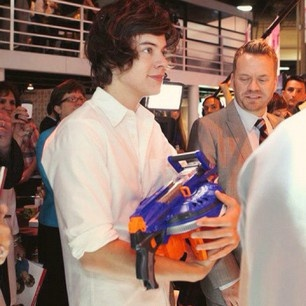 harry and his nurf gun(: hahahaha cutie patootie!