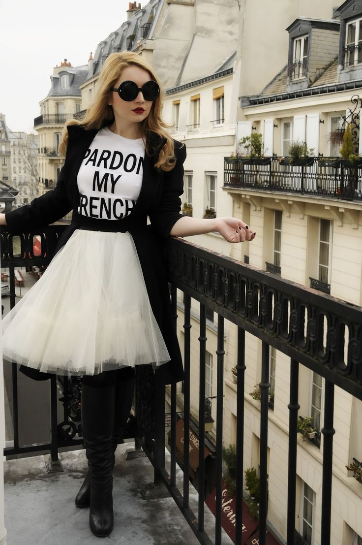 Oh, la, la! Pardon my French! | Fashezine / White tulle knee length skirt / B & W message t shirt / Black tights / black shoes boots / black belt / black coat