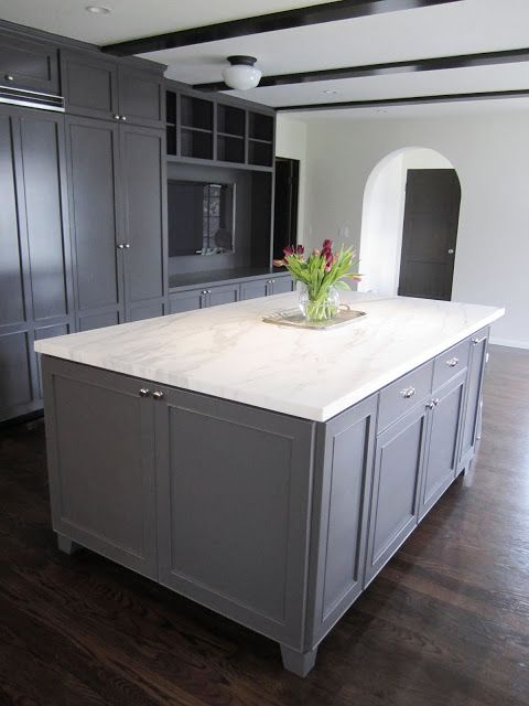 Calacatta gold marble, dark wood floor and grey cabinets and drawers
