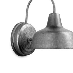 Just $20 each, Lowe's barnyard-inspired sconces in galvanized tin look right at home illuminating classic, clean-lined medicine cabinets.