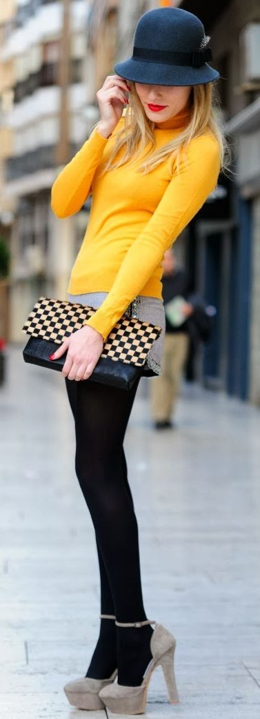 Yellow sweater,skirt,black leggings and pumps