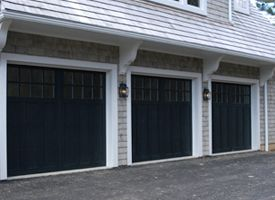 Black garage doors with brick - Black Doors