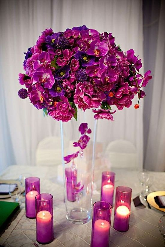 Purple wedding centerpiece and candles