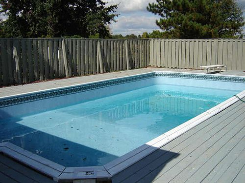 Pin by amy bokenham on garden ideas pinterest for How to build a deck around a pool