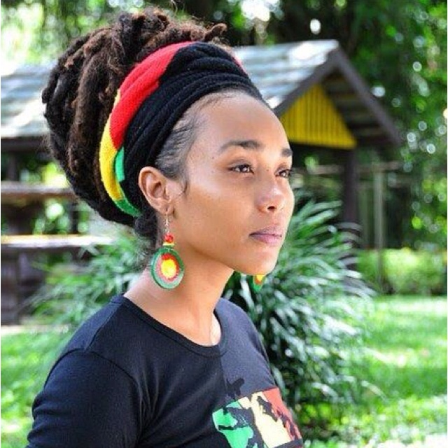 of bright red, gold, and green colors and a dreadlocks hairstyle ...