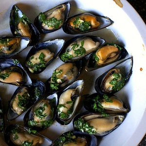Mussels broiled in white wine, butter and a touch of garlic are as ...