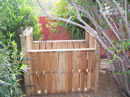 compost bin made from old wood pallets.  This is a great example of GOING GREEN!