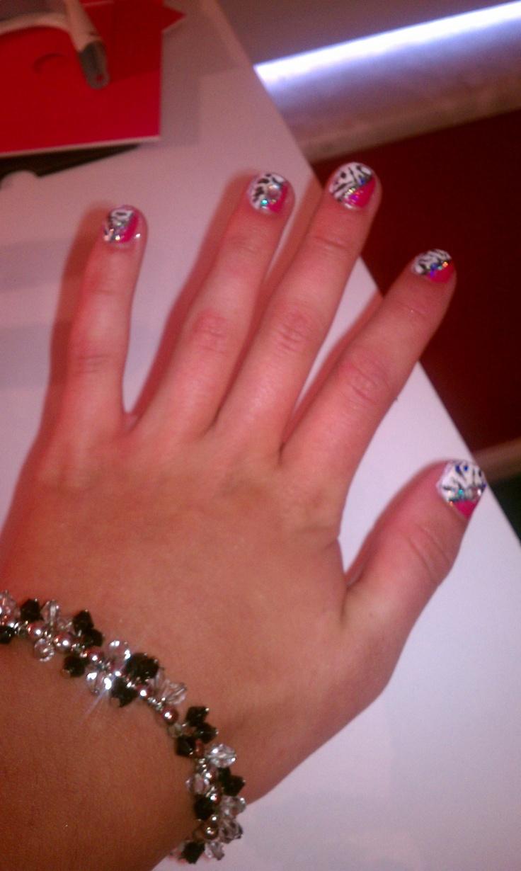 Wild Zebra nail design with jems.