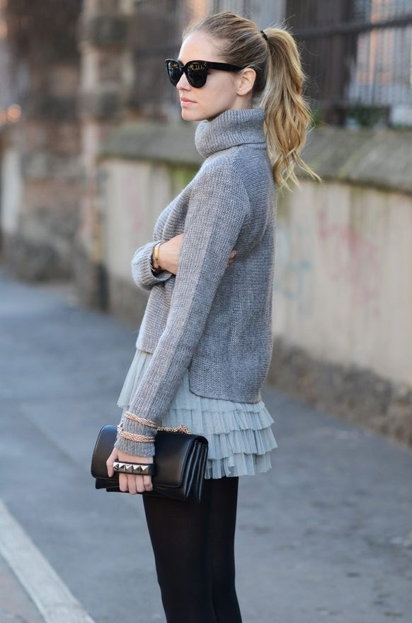grey color necked sweater, layers skirt and black purse