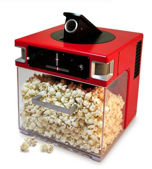 This is The Popinator. It tracks where you voice is coming from and shoots popcorn into your mouth.