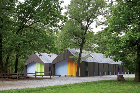 modern cabin with corrugated metal clad facade