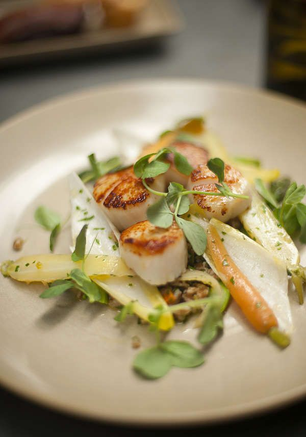 ... sea scallops with asparagus spears -- topped with a coconut curry