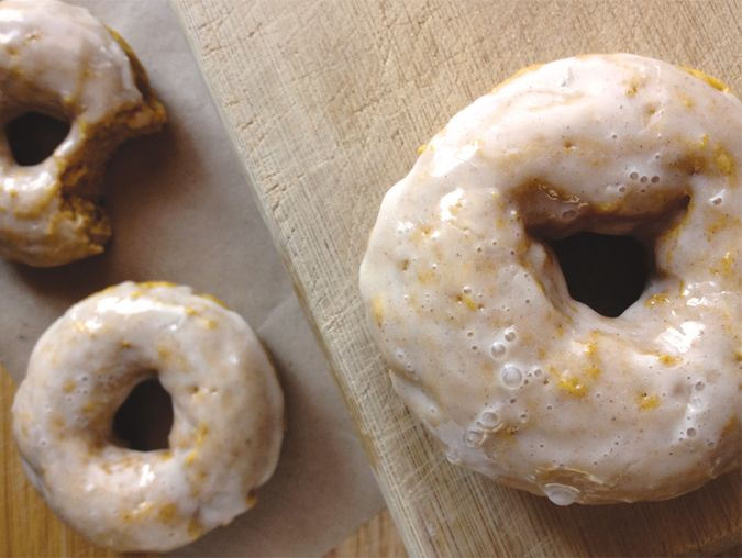 recipe: baked pumpkin spice cake doughnuts with maple cinnamon glaze