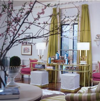 Gray wall color, chartreuse drapes and hot pink chairs...my 3 favorite colors!