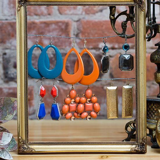 Rework old frames to display earrings.  DIY Jewelry Displays - Blog - Boutique Window  http://www.boutiquewindow.com/blog/articles/diy-jewelry-displays/