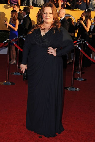 Melissa McCarthy, in Badgley Mischka with Neil Lane jewels and a Badgley Mischka clutch.