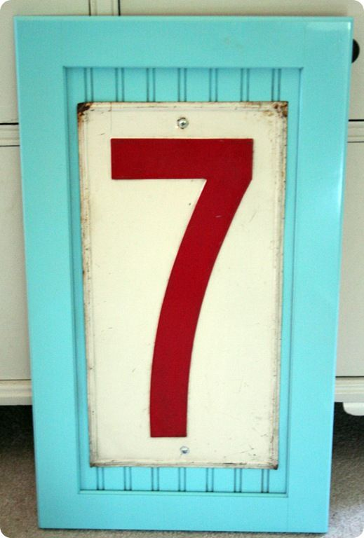 beadboard cabinet door & old gas station number...Seven!