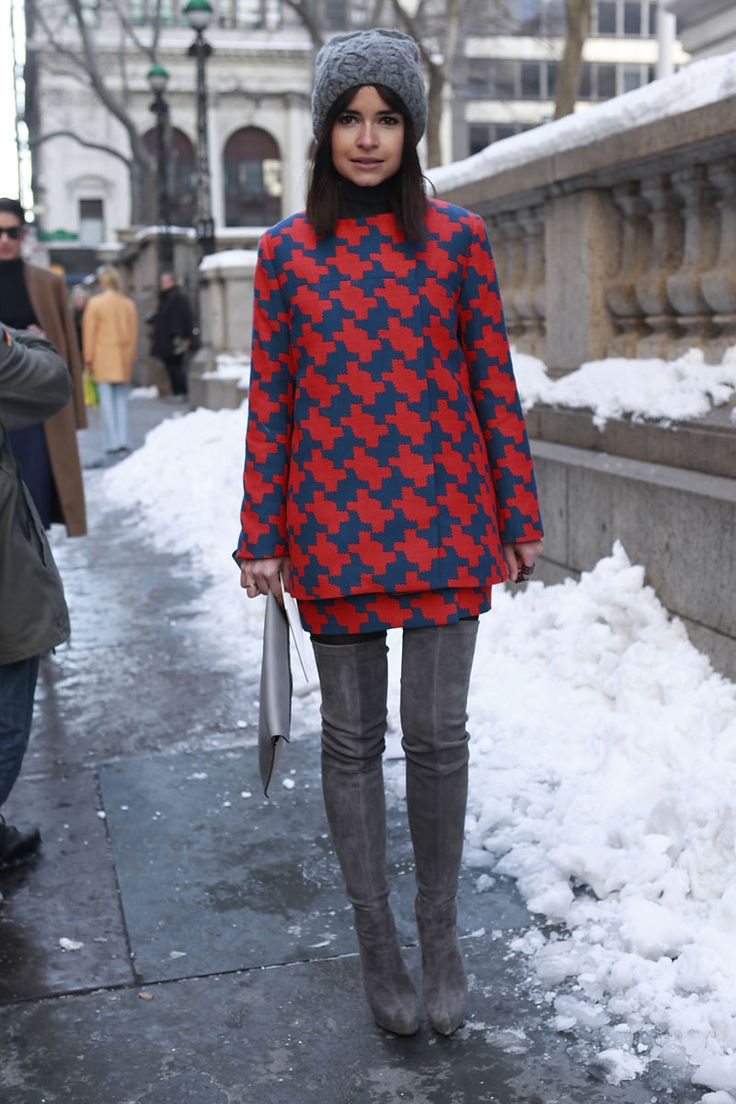 Miroslava Duma in a matching geometric jacket + miniskirt + grey suede over-the-knee boots + grey cable-knit hat