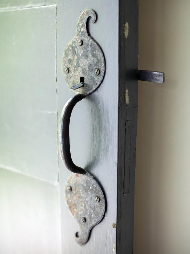 Some of the home's original fixtures, like this door pull and latch, remain intact.