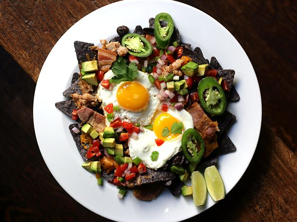 breakfast nachos. eggs, with black beans, avocado. bacon, sausage, and ...