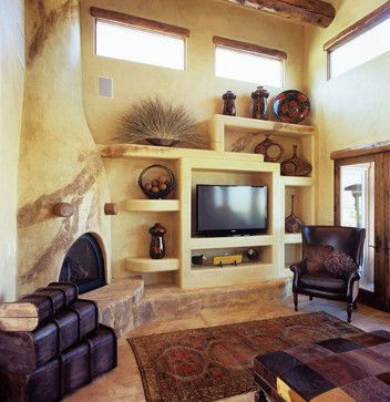Kiva fireplace and pueblo design adobe house interiors for Kiva fireplace