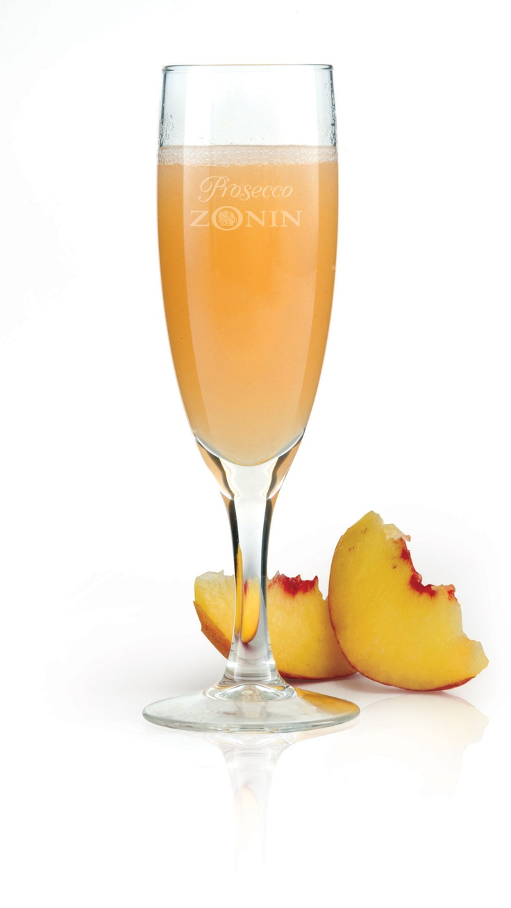 ... peach into a flute. Slowly pour Zonin Prosecco to fill the flute. Stir