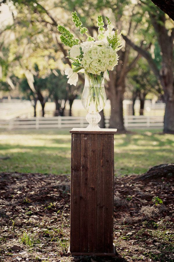 Green and white on palette pedestal. Photography by