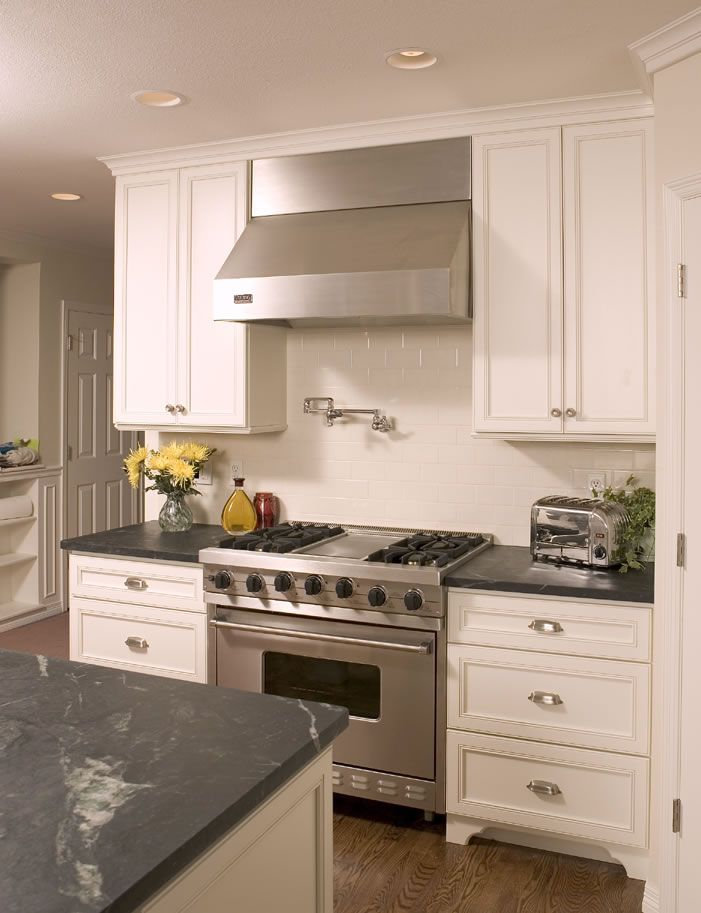 This is just beautiful! Soapstone counters are gorgeous! White subway ...