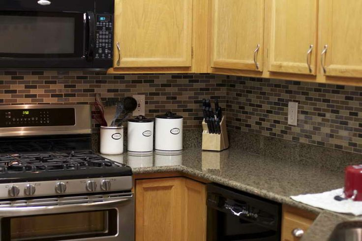 peel and stick tile backsplash oak cabinets how to work around