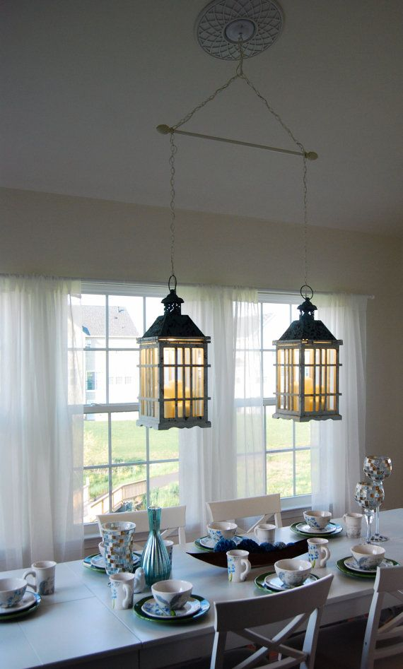 dual dining room lantern chandelier hanging by delilahscloset